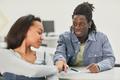 Teenagers passing notes in school - PhotoDune Item for Sale