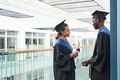 Two college graduates chatting - PhotoDune Item for Sale