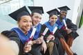 College graduates taking selfie outdoors - PhotoDune Item for Sale