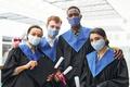 Portrait of diverse college graduates wearing masks - PhotoDune Item for Sale