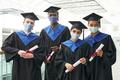 Diverse group of graduates wearing masks - PhotoDune Item for Sale