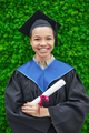 Woman in graduation gown outdoors - PhotoDune Item for Sale