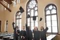 Graduates throwing hats in air indoors - PhotoDune Item for Sale