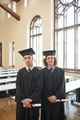 Two men in graduation gowns and caps - PhotoDune Item for Sale