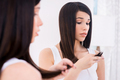 Examining her damaged hair. - PhotoDune Item for Sale