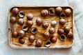 Top view of macadamia nuts on a wooden bowl - PhotoDune Item for Sale