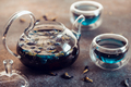 Thai Butterfly pea tea in a glass teapot and cups on a table. - PhotoDune Item for Sale