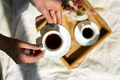 Woman sitting on the bed, and drink coffee during the morning sunlight - PhotoDune Item for Sale
