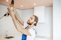 Handyman replacing lightbulb at home - PhotoDune Item for Sale