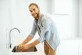 Man washing apple at home - PhotoDune Item for Sale