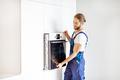 Workman installing kitchen oven - PhotoDune Item for Sale