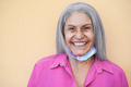 Senior woman wearing face protective mask during coronavirus outbreak - Focus on face - PhotoDune Item for Sale