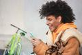 Black millennial biker guy using smartphone outdoor - Focus on fave - PhotoDune Item for Sale