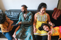 Happy indian family playing together at home sitting on sofa - Focus on woman - PhotoDune Item for Sale