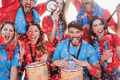 Crazy football supporters playing drums and screaming while supporting their team - PhotoDune Item for Sale