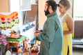 Indian husband and wife celebrating Diwali or hindu festival at home - Focus on man face - PhotoDune Item for Sale