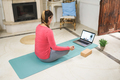 Young woman doing yoga meditation online video class at home - Focus on face - PhotoDune Item for Sale