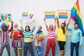 Gay people having fun at pride parade with LGBT flags and banners outdoors - PhotoDune Item for Sale