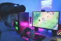 Gamer playing at computer game using joypad - PhotoDune Item for Sale