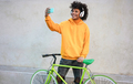 Young millennial african guy making video call on mobile phone outdoors in the city - Focus on face - PhotoDune Item for Sale