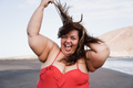 Curvy overweight woman smiling with beach on background - Focus on face - PhotoDune Item for Sale