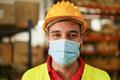 Portrait of man worker inside warehouse wearing safety mask for coronavirus prevention - PhotoDune Item for Sale