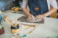 Woman making ceramics objects inside creative pottery studio - PhotoDune Item for Sale