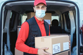Hispanic delivery man wearing safety mask for coronavirus prevention - Focus on face - PhotoDune Item for Sale