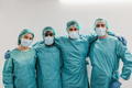 Portrait of young medical workers looking at camera inside hospital corridor - PhotoDune Item for Sale