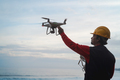 Engineer pilot man holding drone before flight - Focus on right hand - PhotoDune Item for Sale