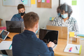 Young people working inside modern office behind plexiglas - Focus woman face - PhotoDune Item for Sale