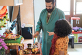 Father and son celebrating Diwali or hindu festival at home - Focus on man face - PhotoDune Item for Sale