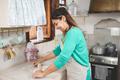 Happy woman preparing fajitas wrap at home inside vintage kitchen - PhotoDune Item for Sale