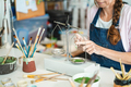 Artist woman mixing painting colors with vintage balance at pottery workshop studio - - PhotoDune Item for Sale