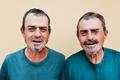 Senior twin men smiling on camera - Focus on faces - PhotoDune Item for Sale