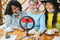 Multiracial girls streaming online using influencer led and phone cam during coronavirus outbreak - PhotoDune Item for Sale