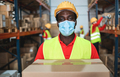 African man worker inside warehouse loading delivery boxes while wearing safety mask - PhotoDune Item for Sale