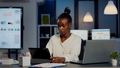 African manager woman using laptop and tablet in same time working overtime - PhotoDune Item for Sale