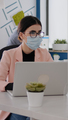 Business people with medical face masks working together in new normal office - PhotoDune Item for Sale