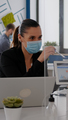 Close up of coworkers with face mask working together at financial project - PhotoDune Item for Sale