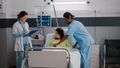 Medical practitioner doctor checking sick woman monitoring disease symptom - PhotoDune Item for Sale