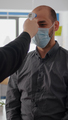 Freelancer man wearing protective mask against covid19 while checking temperature - PhotoDune Item for Sale