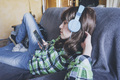Young woman at home enjoying music - PhotoDune Item for Sale