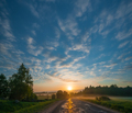 Morning landscape with road passing through field at sunrise. - PhotoDune Item for Sale