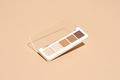 Make-up palette floating over a beige background - PhotoDune Item for Sale