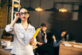 Woman working in modern office using devices and gadgets during creative meeting - PhotoDune Item for Sale