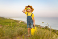 Happy child against blue sea and sky background - PhotoDune Item for Sale