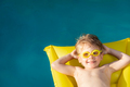 Happy child swimming on summer vacation - PhotoDune Item for Sale