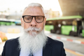 Senior hipster business man waiting at bus station - Focus on face - PhotoDune Item for Sale