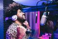 African singer recording new music album inside boutique studio - Main focus on face - PhotoDune Item for Sale